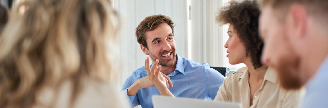 employees talking in meeting how we work