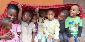 Kilimanjaro Mama Monika and children